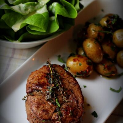 Grilled Beef filet mignon recipe with baby potatoes and onions and lettuce salad